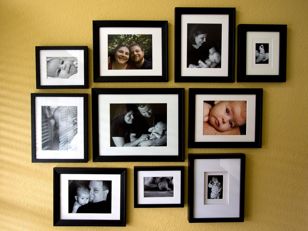 Photos of kids with family on the wall.Photo courtesy : Flikr.com